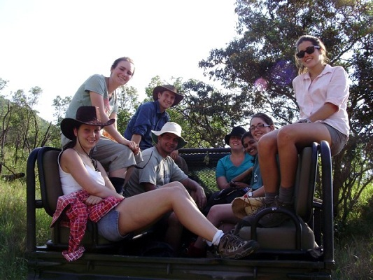 A group of volunteers relaxing on the back of the truck